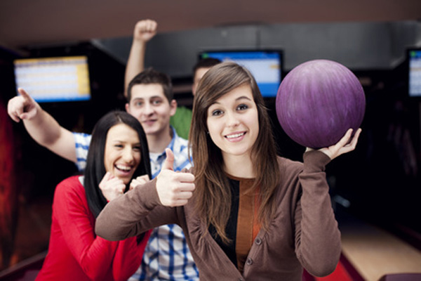 Friends bowling